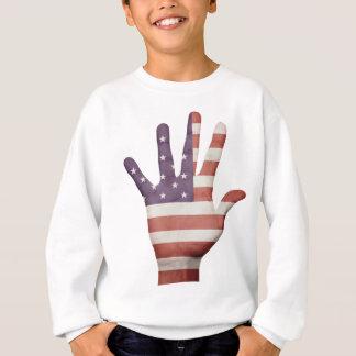 Mano de la bandera americana polera