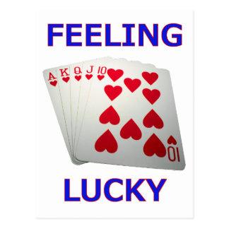 Mano de póker afortunada de sensación de la postal