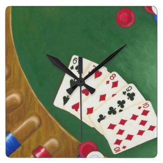 Mano de póker que gana seis a diez reloj cuadrado
