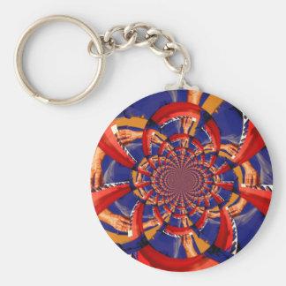 mano del caleidoscopio que juega el azul anaranjad llavero redondo tipo pin