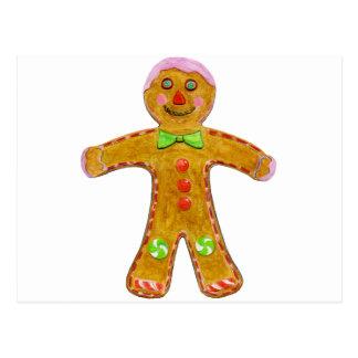 Mano del hombre de pan de jengibre del navidad postal