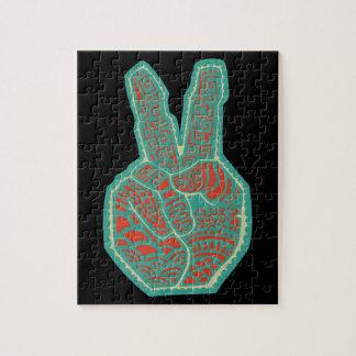 Mano del símbolo de paz puzzles