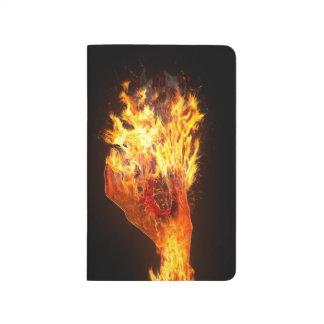 Mano en el fuego cuaderno
