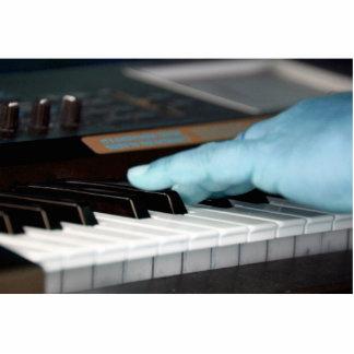 mano izquierda eléctrica azul del piano que juega  escultura fotografica