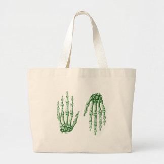 Mano para arriba abajo del verde bolsas de mano