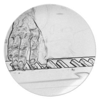 mano que juega el esquema de la tinta del bw del t plato para fiesta