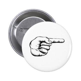 Mano que señala el ejemplo del dedo pins