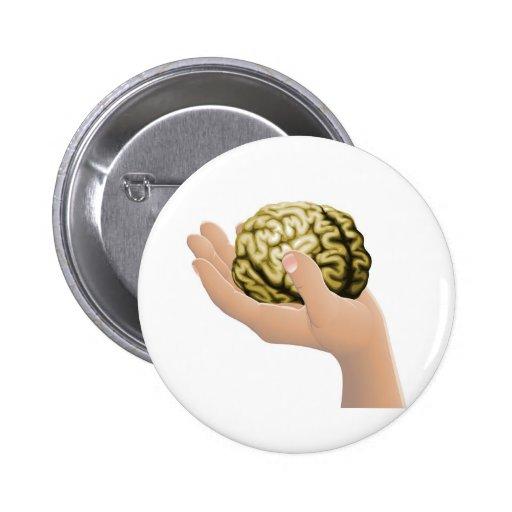 Mano que sostiene un cerebro pin