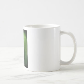 Mano verde en colores pastel (simbolismo taza de café