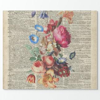 Manojo de flores coloridas en una página del papel de regalo