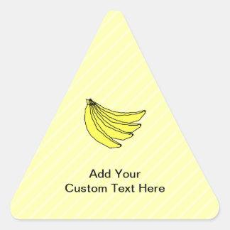 Manojo de plátanos amarillos pegatina triangular