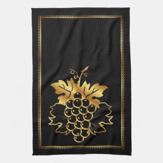 Manojo de uvas de oro con el marco de oro del orna toallas