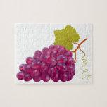 Manojo delicioso de uvas rojas puzzles