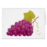 Manojo delicioso de uvas rojas tarjeta