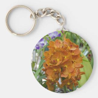 Manojo elegante de foto anaranjada de las orquídea llaveros