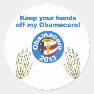 Manos de mi pegatina de Obamacare