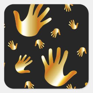 manos de oro pegatina cuadrada