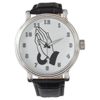 Manos de rogación relojes de pulsera