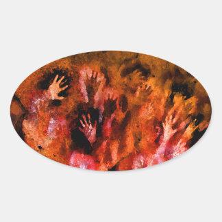 Manos del fuego pegatina ovalada