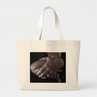 manos en bolso del bebé bolsa lienzo