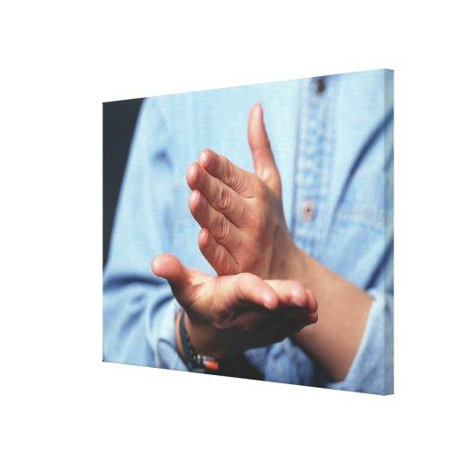 Manos que hacen gesto: uno de mano derecho lienzo envuelto para galerías