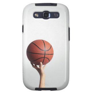 Manos que llevan a cabo un baloncesto, primer de l galaxy SIII funda