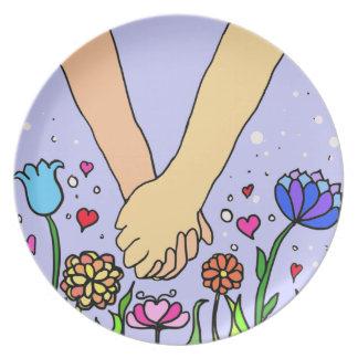 Manos que se sostienen románticas - datación/regal platos