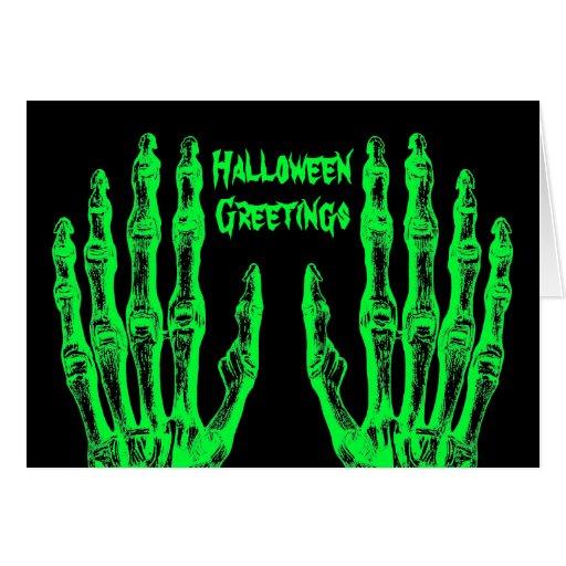 Manos verdes de neón fantasmagóricas del zombi de  tarjeton