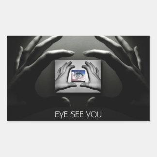 Manos y pegatina frescos del ojo