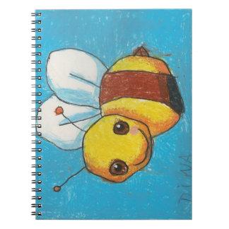 Manosee el cuaderno de la abeja