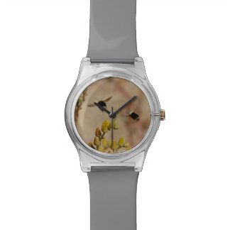 Manosee el reloj de la abeja