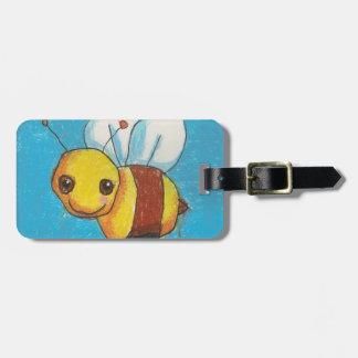 Manosee la etiqueta del equipaje de la abeja/de la