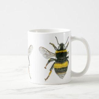 Manosee la taza de la abeja