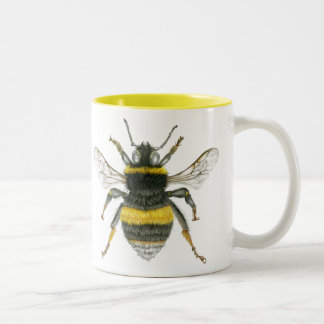 Manosee la taza del tono de la abeja dos