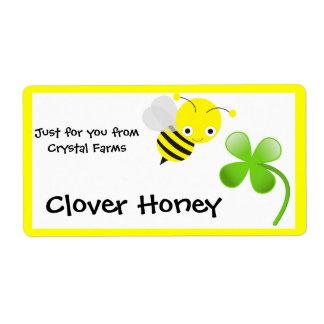 Manosee las etiquetas de la comida de la abeja y d etiqueta de envío