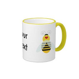 manosee los cuties de la abeja taza a dos colores
