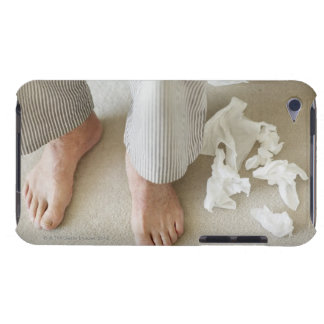 Man's feet surrounded by crumpled tissues barely there iPod cases