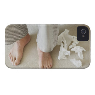 Man's feet surrounded by crumpled tissues iPhone 4 Case-Mate case