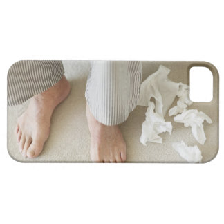 Man's feet surrounded by crumpled tissues iPhone SE/5/5s case
