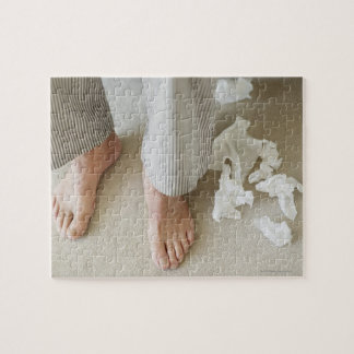 Man's feet surrounded by crumpled tissues jigsaw puzzles