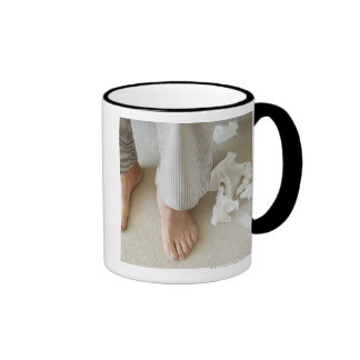Man's feet surrounded by crumpled tissues ringer coffee mug