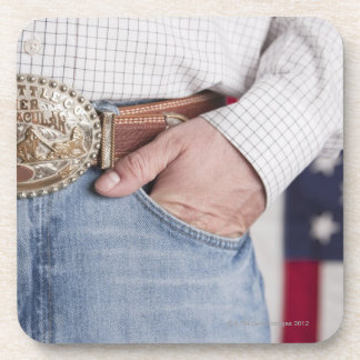 Man's hand in the pocket of his jeans drink coaster