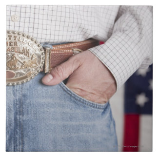 Man's hand in the pocket of his jeans large square tile