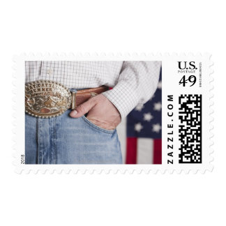 Man's hand in the pocket of his jeans postage