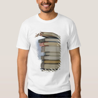 Man's hand taking a book from a stack of books tee shirt