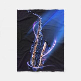 Manta azul del paño grueso y suave del saxofón