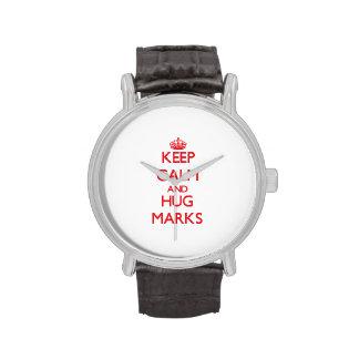 Mantenga las marcas tranquilas y del abrazo reloj
