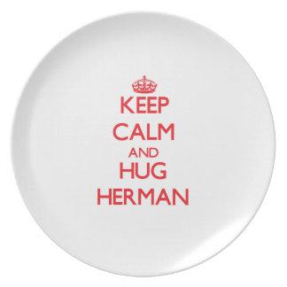 Mantenga tranquilo y abrazo Herman Platos