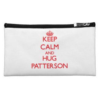 Mantenga tranquilo y abrazo Patterson