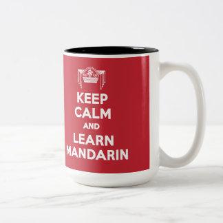 Mantenga tranquilo y aprenda la taza del mandarín